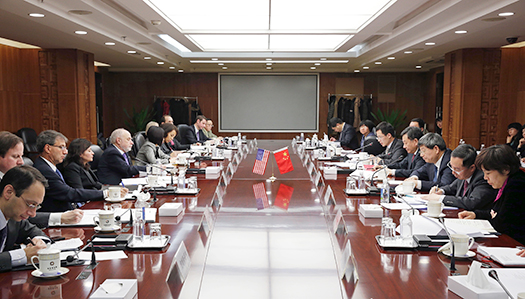 U.S. and China officials seated in the conference room for the meetings