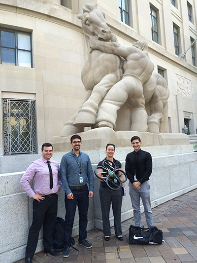 Photo of OTech's interns standing outside the FTC headquarters building with a drone