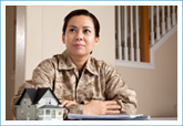 military female sitting at table to make home purchase