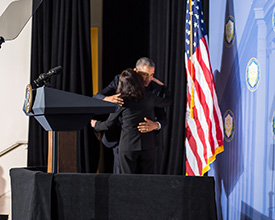 President Obama greets Chairwoman Ramirez with a hug.