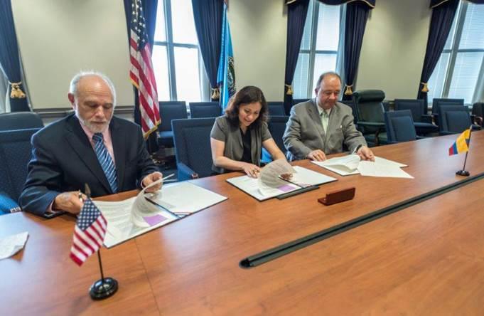 People signing the Memorandum of Understanding
