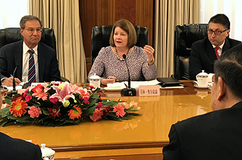 FTC and Chinese Anti-Monopoly Agencies officials in a meeting