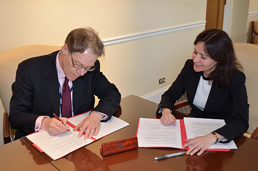 FTC Chairwoman and UK Information Commissioner seated at a table signing the memo