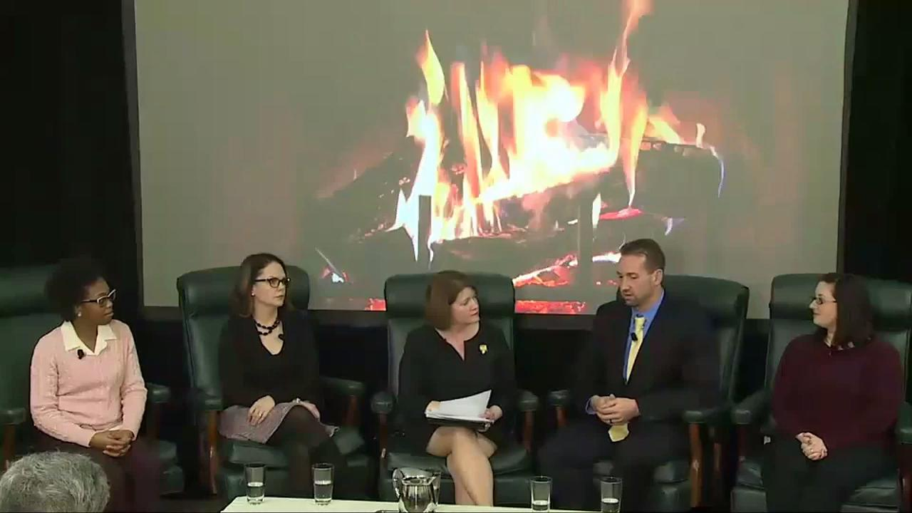 fireside chat participants seated in front of fireplace image